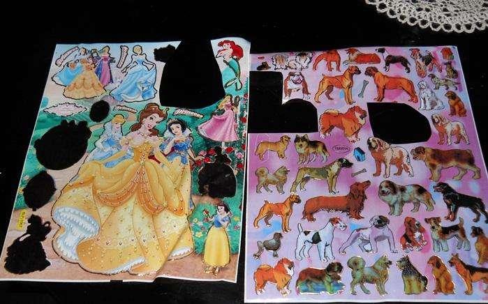 2 laminas de stickers incompletas princesas y razas de perro