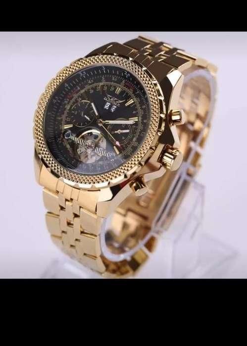 Reloj dorado inoxidable de acero de lujo