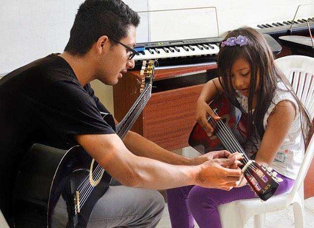 Clases de Guitarra Y Vocalización