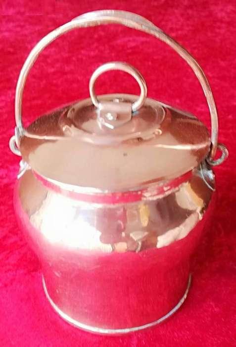 Antigua caramelera de cobre