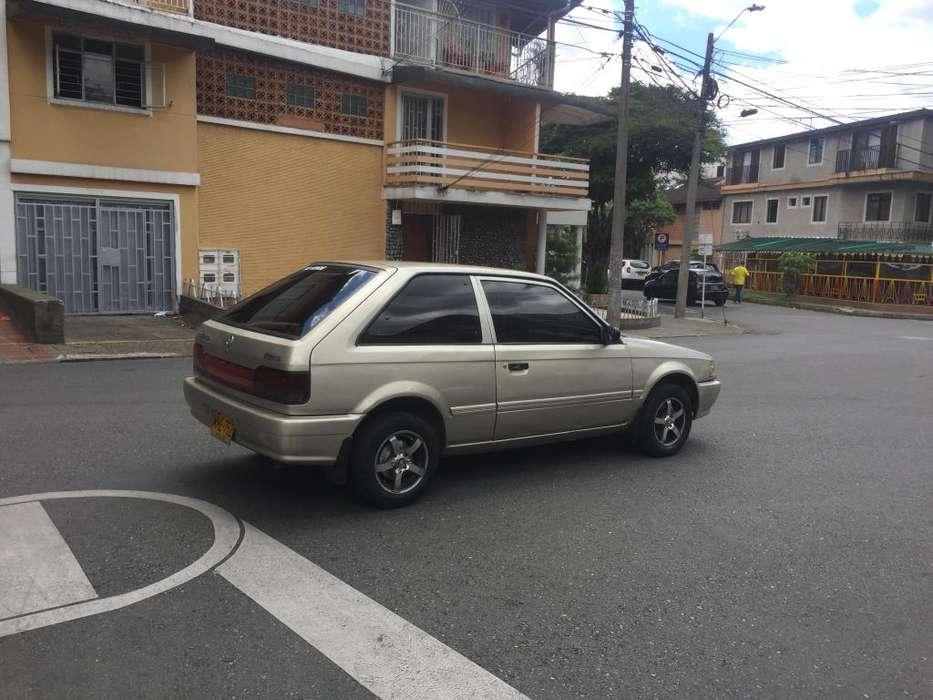 Mazda 323 1998 - 165000 km