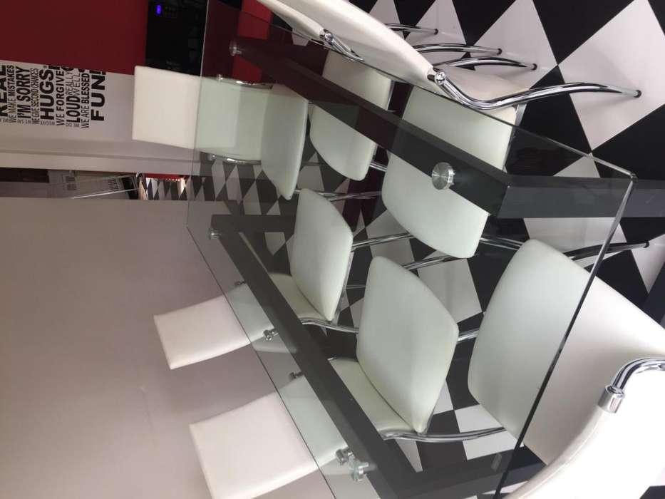 Mesa de hierro negro y vidrio templado con 8 <strong>silla</strong>s de ecocuero y patas cromadas
