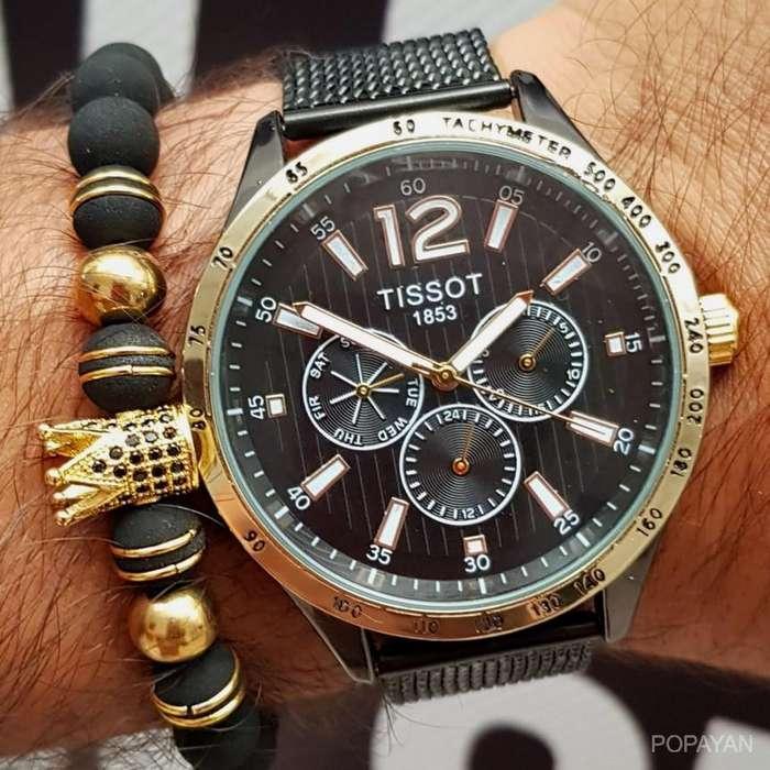 p) Tissot negro con dorado funcional 130 caballeros