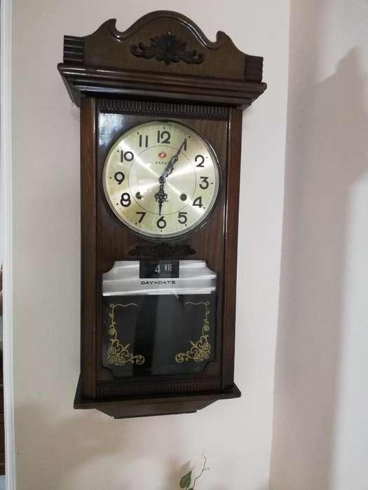 Hermoso Reloj de Pendulo