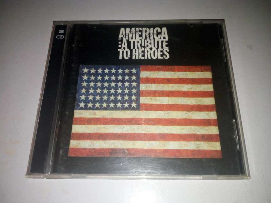 Vendo o cambio, disco doble original , CD, AMERICA: A TRIBUTE TO HEROES, varios artistas, en perfecto estado Q.100