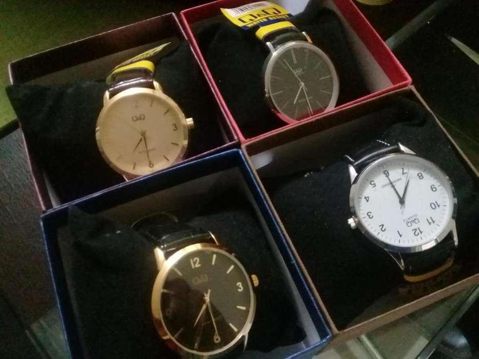 Relojes elegantes de marca QyQ de correa varios modelos