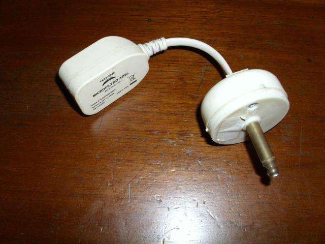 Adaptador teléfono a ficha americana