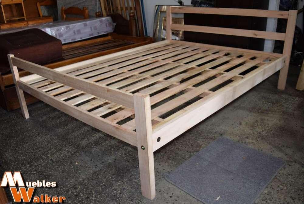 <strong>camas</strong> de saligna 1,40 x 1,90cm. con 2 patas centrales