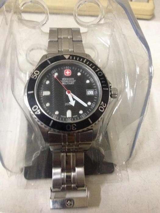 reloj suizo original wenger swiss military.cambio por celular.
