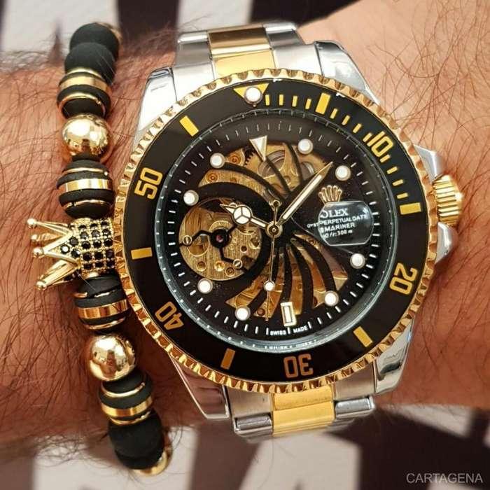 Reloj Rolex fondo negro con dorado maquinaria abierta para caballero en venta