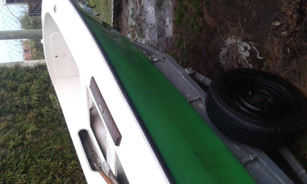 casco pescador con motor evinrude 35 permutaria