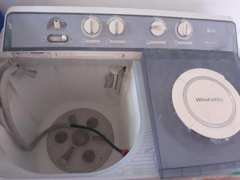 Vendo lavadora LG 14 k totalmente funcional en 650 mil negociabl