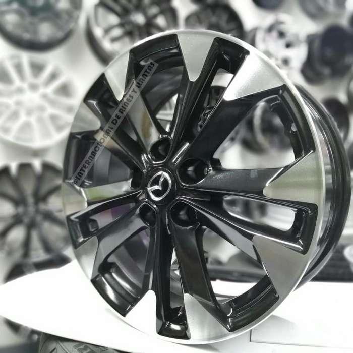 Rines 17 negro maquinado 5 huecos 114 mm