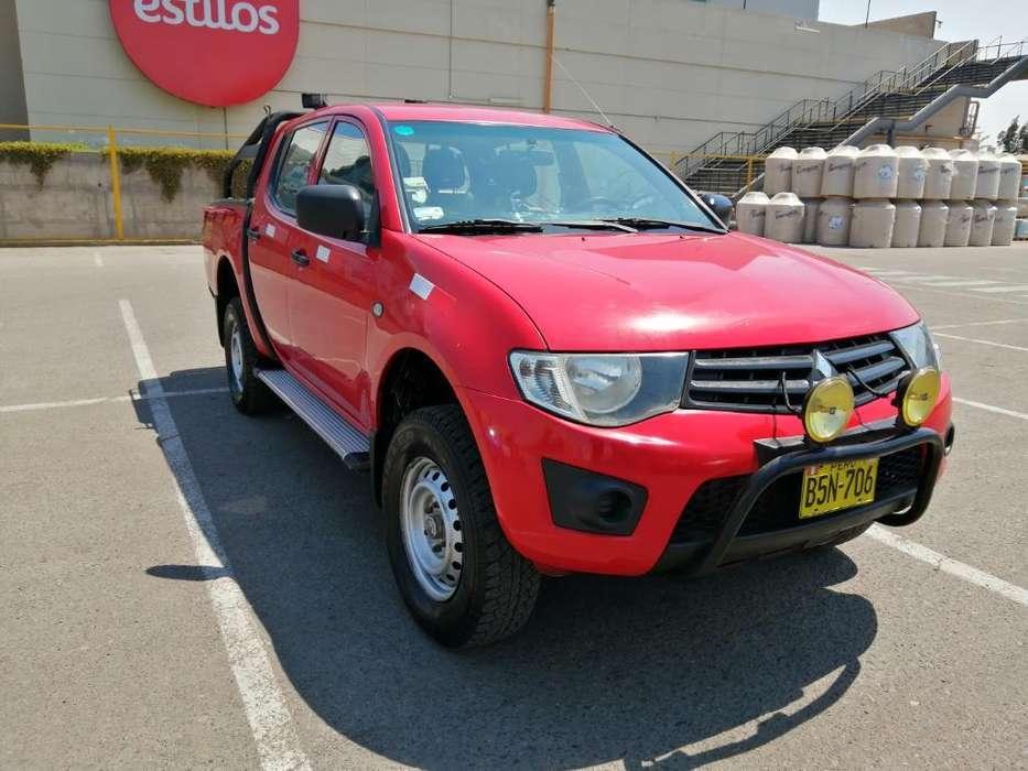 Mitsubishi L200 2011 - 112823 km