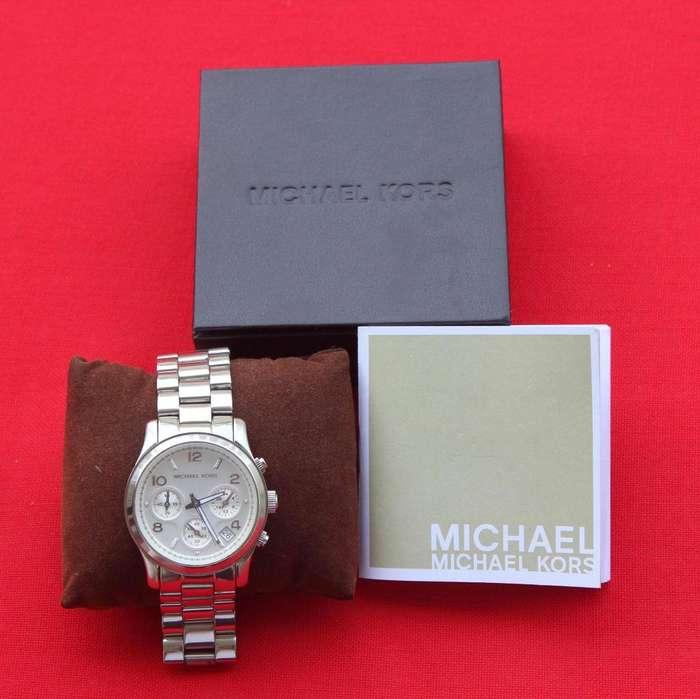 Reloj Michael Kors plateado dama