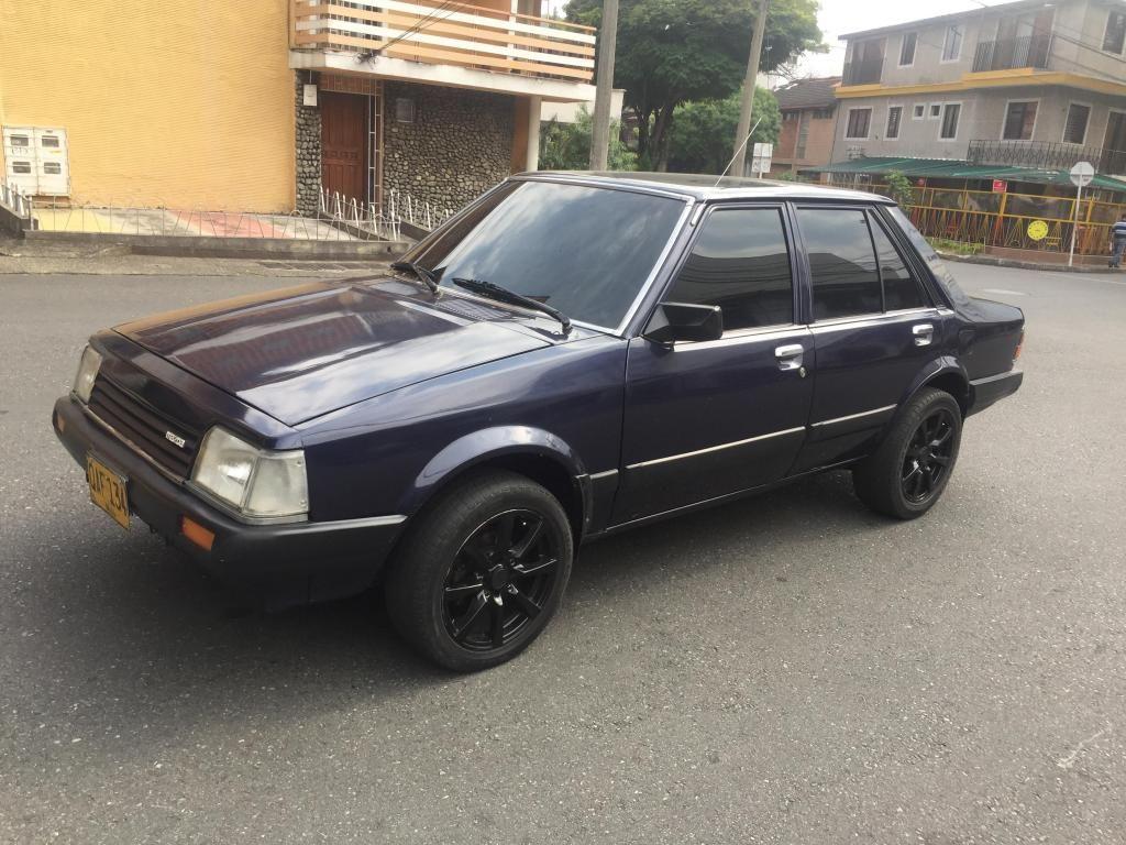 MAZDA 323 MODELO 85 AUZL OSCURO MOTOR 1.500cc CAJA QUINTA CON DVD Y CAMARA DE REVERSA...