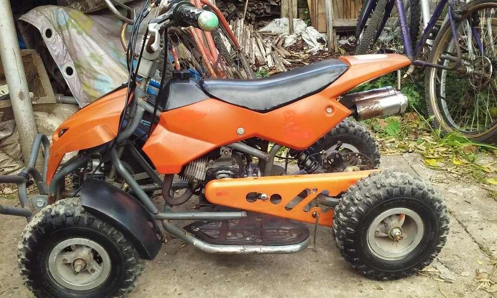 minicuatriciclo 49 cc 2 tiempos para niños