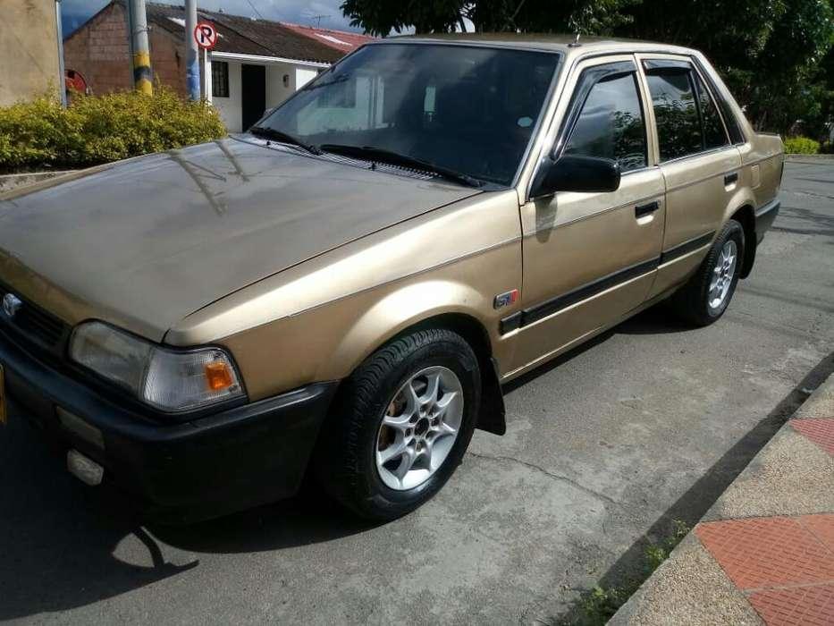 Mazda 323 1989 - 456789 km