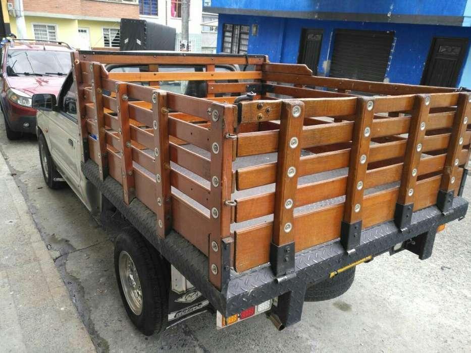 3166936094 Camionetas Acarreos Motogrua