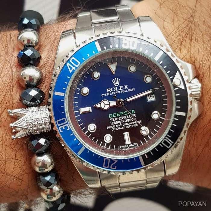 l) Rolex deepsea plateado con azul y negro difuminado 90 hombres