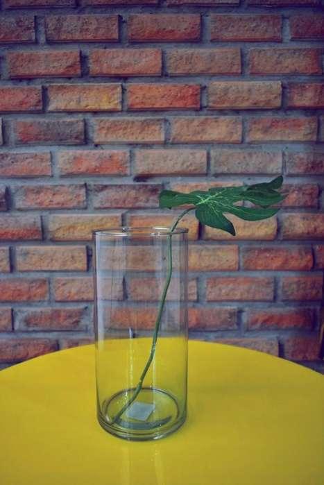 florero cilindrico en vidrio
