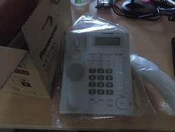 Teléfono manos libres Panasonic, identificador de llamadas y conector para auriculares KX-T7716 (NUEVO)