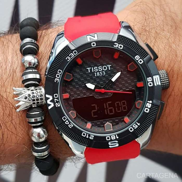Se vende Tissot en color rojo con negro y plateado para hombre