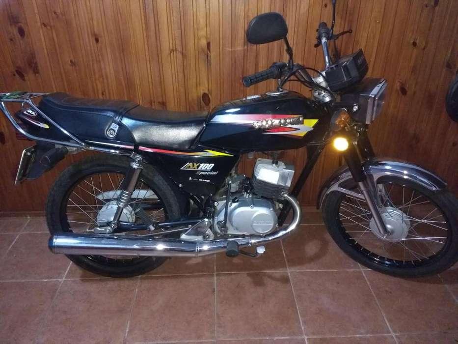 Vendo Susuki Ax 100 38000