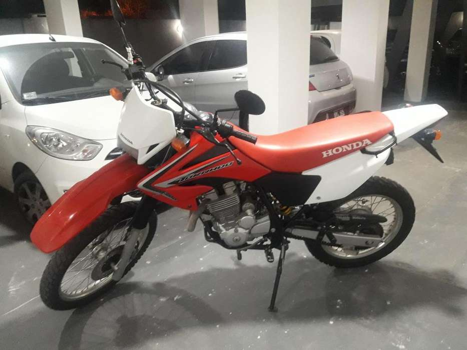 VENDO HONDA TORNADO. IMPECABLE