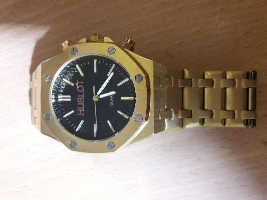 reloj Hublot dorado