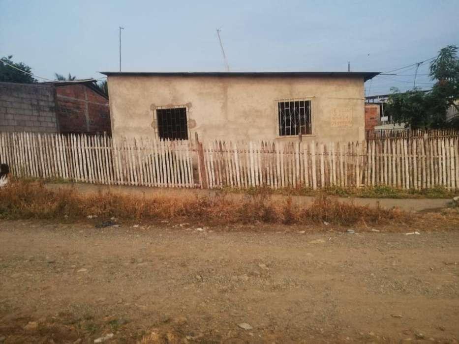 Venta de Solar con Casa Construida