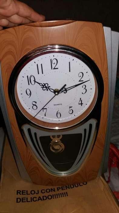Reloj con Pendulo
