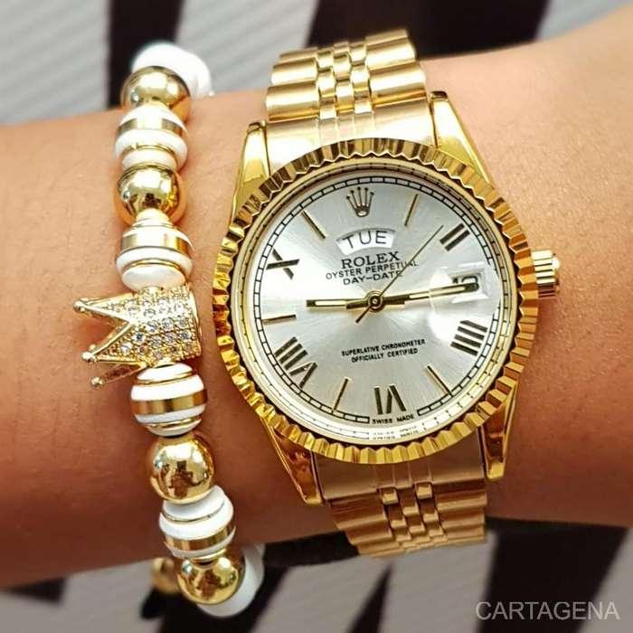 Se vende Rolex en color dorado para mujer