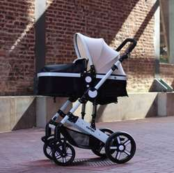 Coche de bebe linea blanca y black