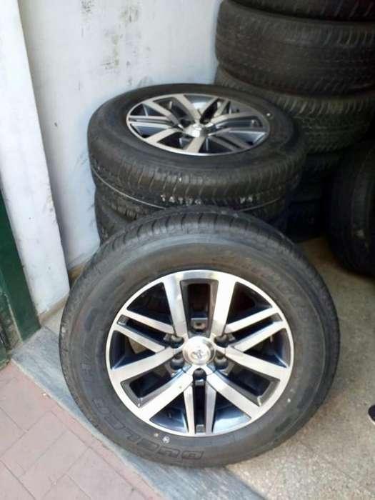 TOYOTA HILUX <strong>llanta</strong>s SRX SW4 NUEVAS CON CUBIERTAS SIN PISAR Bridgestone 265 60 18 y centro