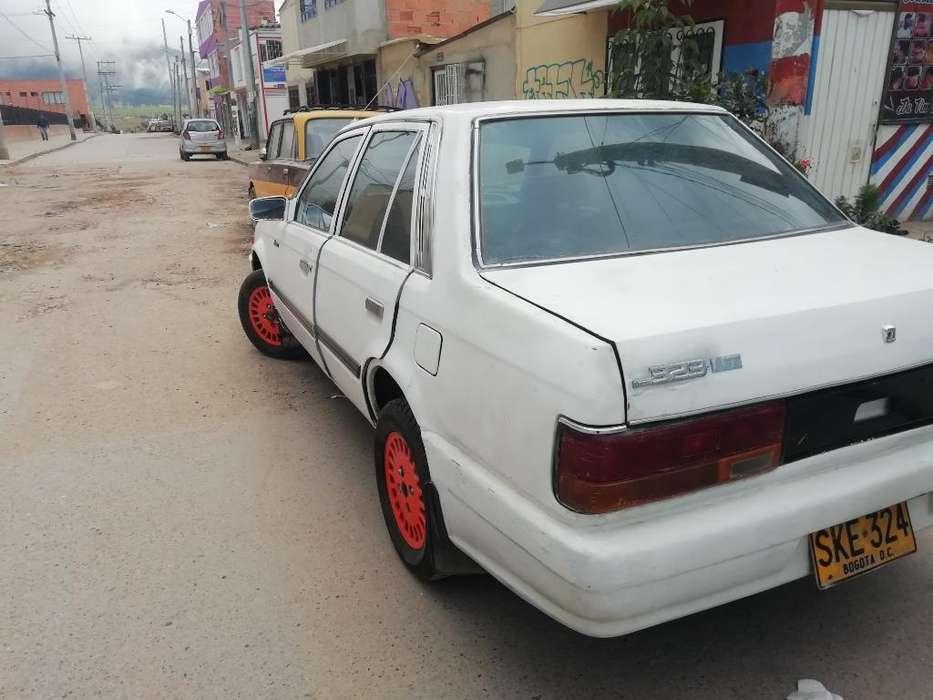 Mazda 323 1988 - 150000 km