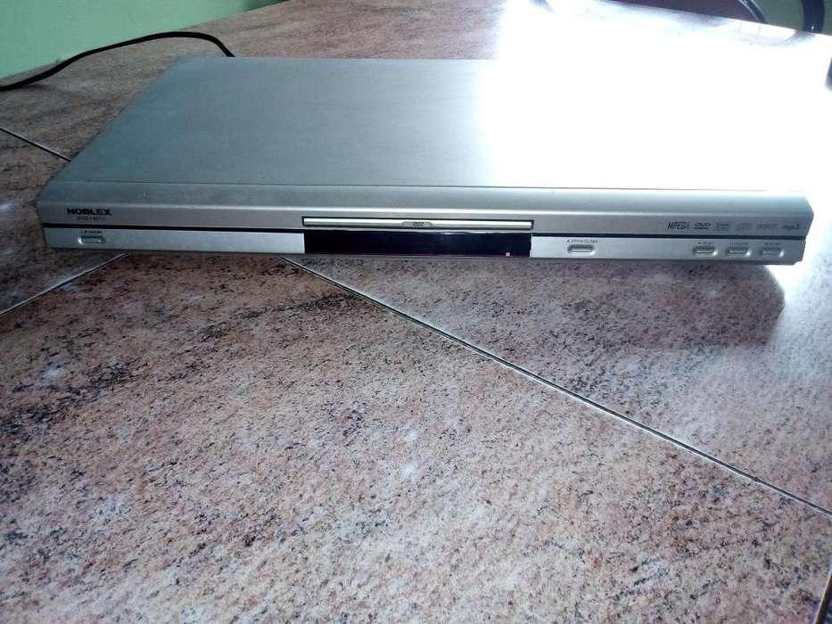 DVD REPRODUCTOR NOBLEX C/CONTROL REMOTO y manual.