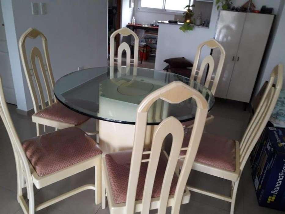 juego de comedor con mesa de vidrio y 6 sillas