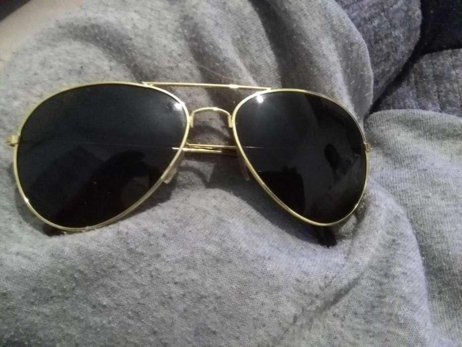 Anteojos estilo rayban aviador de buena calidad dorados metal exelente