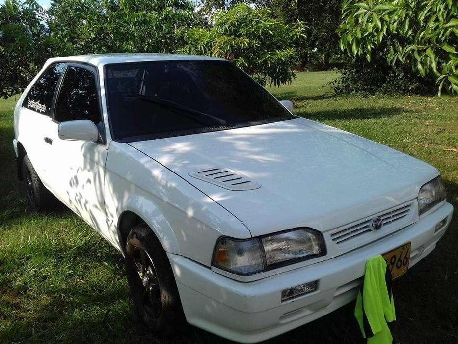 Mazda 323 1998 - 9000 km