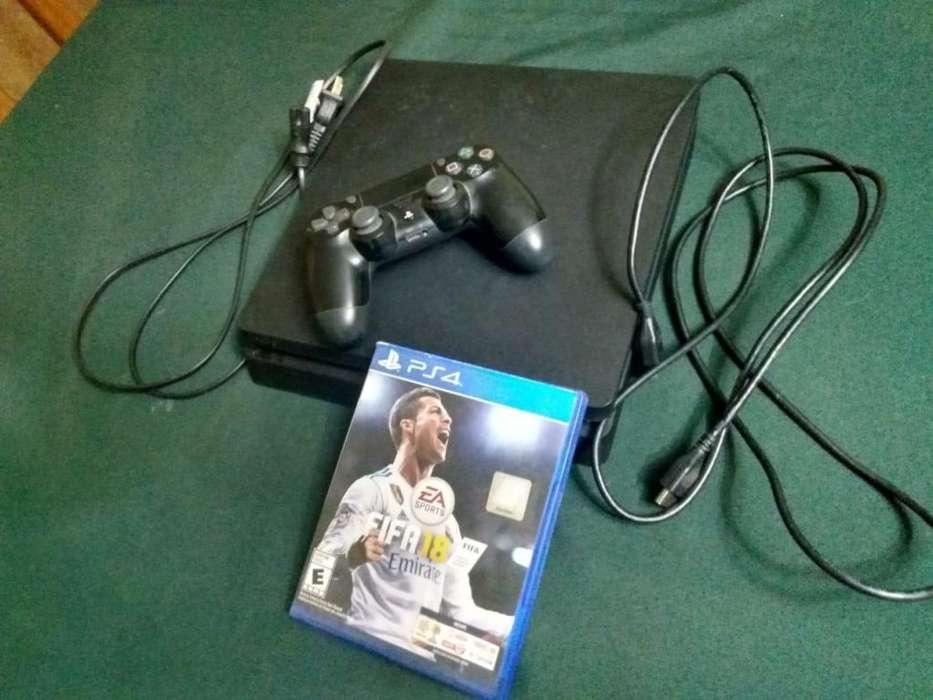 Ps4 Slim 1TB con un Joystick y FIFA18
