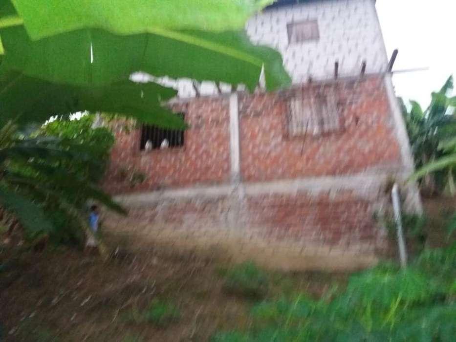 Vendo Terreno con Una Casa de Dos Piso.