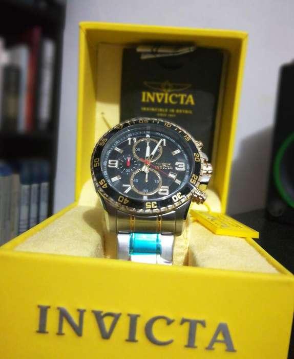 Reloj Invicta Specialty dorado, oro, 2 tonos. Relojes hombre Fossil Guess Rolex.