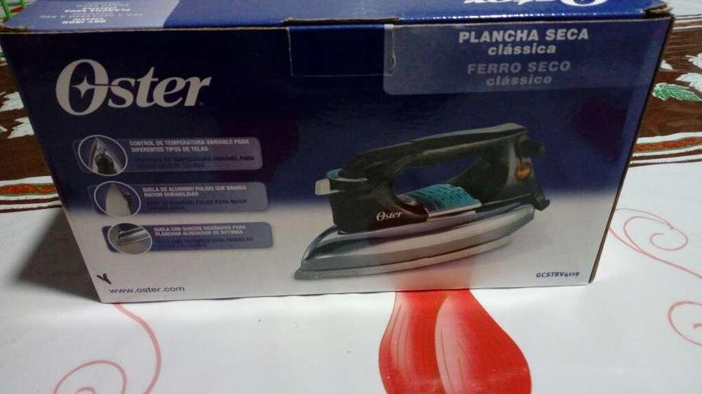 Vendo Plancha Oster