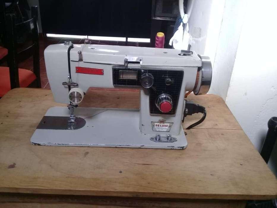 Maquina de coser marca BROTHER en petfecto estado