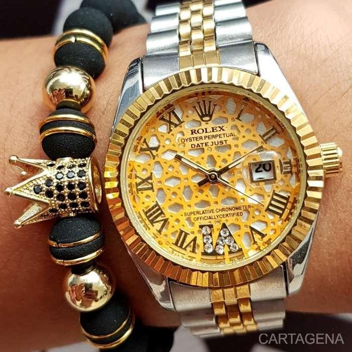 Reloj Rolex dorado con plateado a la venta para dama