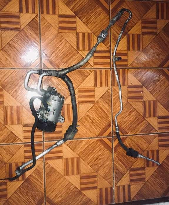 Sistema de Aire Acondicionado Compresor