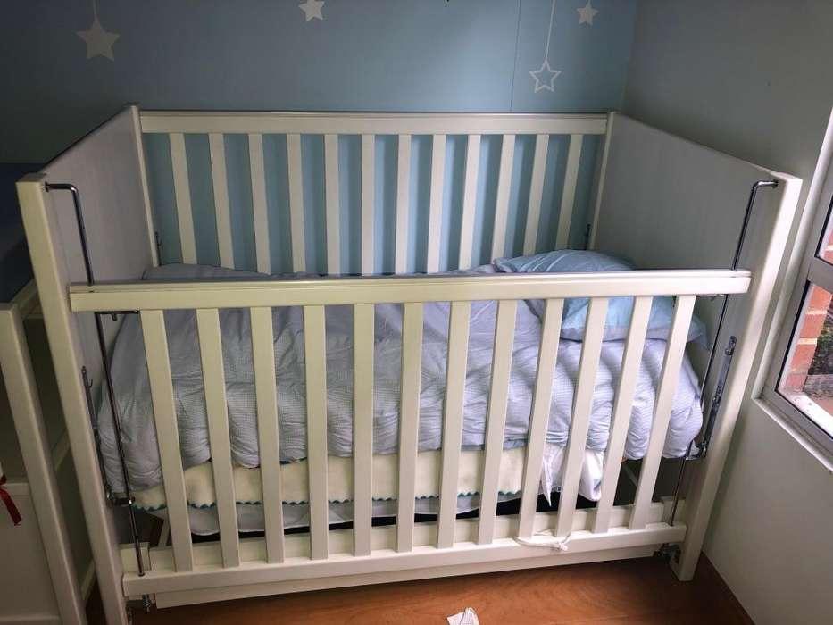 Cuna para bebé y mueble cambiador con cajon