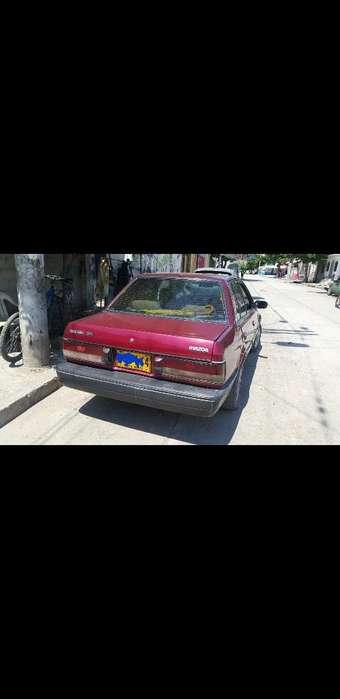 Mazda 323 1994 - 123456 km