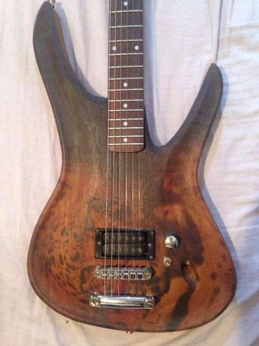 Vendo o Cambio guitarra electrica acabado de madera